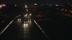 High-speed two-way traffic on a highway at night Stock Footage
