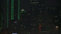 Slow zoom-out from skyscrapers of downtown Dallas at night Arkistovideo