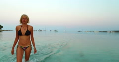 Blonde woman getting out of the sea at Slatinica beach, Croatia Stock Footage