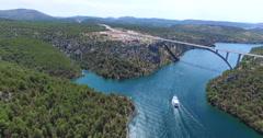 Aerial view of boat sailing towards Krka bridge, Croatia Stock Footage