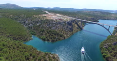 Aerial view of boat sailing towards Krka bridge, Croatia Stock Footage