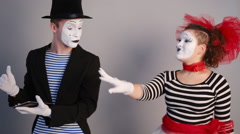 Mimes looking at tablet pc Stock Footage
