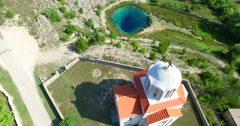 Aerial view of church next to the source of Cetina river, Croatia Stock Footage