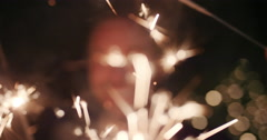 Sexy group of friends at glamorous party lighting sparklers Stock Footage