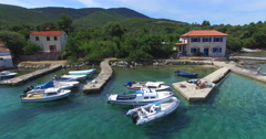 Aerial view of small harbor on Island of Cres, Croatia Stock Footage