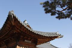 Gyeongbokgung roof form with wood structure architecture in Korea - stock photo