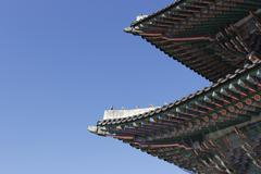 Gyeongbokgung roof layers with animal on top historic architecture - stock photo