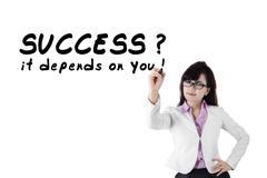 Female motivator writes advice words 1 Stock Photos
