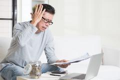 Having a hard time paying bills. - stock photo