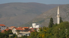Beautiful view of houses, a minaret and mountains in Mostar Stock Footage