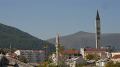 Stock Video Footage of The minaret of tabacica mosque and the tower of the catholic church in Mostar