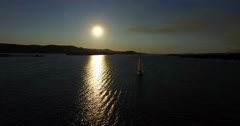 Aerial view of yacht sailing beside Galesnjak Island at sunset, Croatia Stock Footage