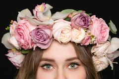 Closeup of woman eyes in beautiful rose wreath Stock Photos