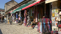 Stock Video Footage of Tourists walking next to Old Town caffee bar in Mostar, Bosnia-Herzegovina