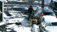 Man uses snow blower winter storm, clears driveway Stock Footage