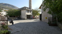 Stock Video Footage of Cobblestone street with old buildings in Mostar, Bosnia-Herzegovina