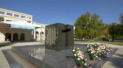 Memorial in front of Intesa Sanpaolo Bank in Mostar, Bosnia-Herzegovina Stock Footage