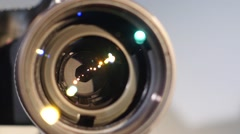 Diaphragm of a camera lens aperture, close up, open, glare Stock Footage