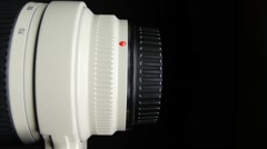 Lens cap with clipping path, on black - stock footage