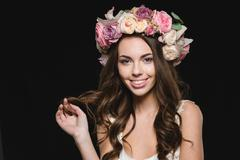 Stock Photo of Attractive cheerful woman with beautiful long hair in flower wreath