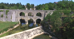 Aerial view of Tounj Bridge, double bridge over river Tounjcica, Croatia Stock Footage