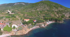 Tourists and boat in bay of Stiniva, Croatia Stock Footage