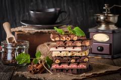 An assortment of white, dark, and milk chocolate - stock photo