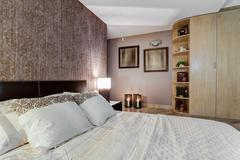 Cozy bedroom with oriental accents Stock Photos