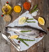 fresh trout with spices and seasonings - stock photo