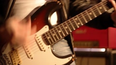 Guitarist. Close-up on a male hand playing on a electric guitar and then stop Stock Footage