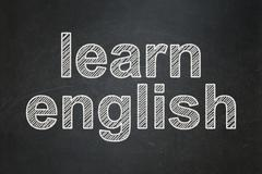 Stock Illustration of Studying concept: Learn English on chalkboard background