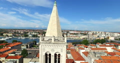 Angel on top of tower of cathedral of St. Anastasia in Zadar, Croatia Stock Footage