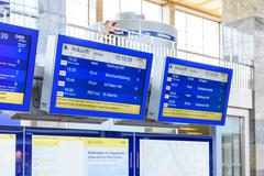 People Looking At Departure And Arrivals Screens In Wien Mitte Station Stock Photos