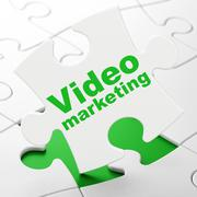 Finance concept: Video Marketing on puzzle background Piirros