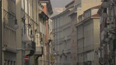 Street with old buildings and street lamps in Trieste Stock Footage