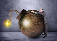 Businessman hugging bomb - stock photo