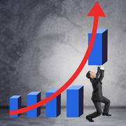 Businessman holding graphical chart Stock Photos