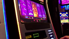 Close up man playing slot machine inside Hard Rock Casino - stock footage