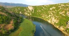 Aerial view of a motor boat speeding on Zrmanja river, Croatia Stock Footage