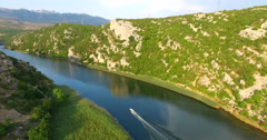 Aerial view of a motor boat speeding on Zrmanja river, Croatia Stock Footage