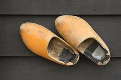 Dutch Clogs on the wooden wall. - stock photo