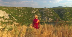 Woman meditating at beautiful Zrmanja river, Croatia Stock Footage