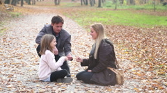 Mom and daughter playing a game of rock, paper, scissors in the park Stock Footage