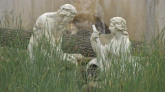 Sculpture fountain seen through grass, Vienna Stock Footage
