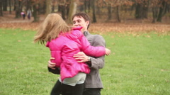 Father playing with daughter in park Stock Footage
