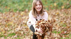 Lovely girl throwing leaves Stock Footage
