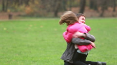 Young dad carries daughter and plays with her in park Stock Footage