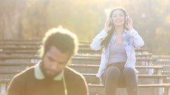 Stock Video Footage of Couple with headphones listening to music and dancing to the rhythm