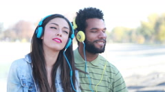 Couple with headphones listening to music and dancing to the rhythm - stock footage