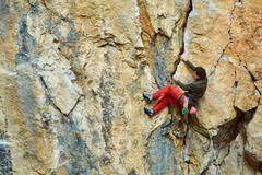 male rock climber - stock photo